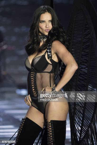 TOPSHOT Brazilian model Adriana Lima presents a creation during the 2017 Victoria's Secret Fashion Show in Shanghai on November 20 2017 / AFP PHOTO /...