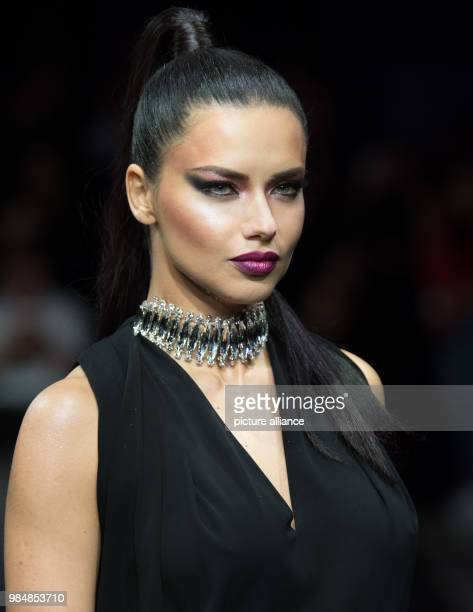 Brazilian model Adriana Lima presents a fashion creation as she walks across the catwalk during the Maybelline Urban Catwalk show at the...