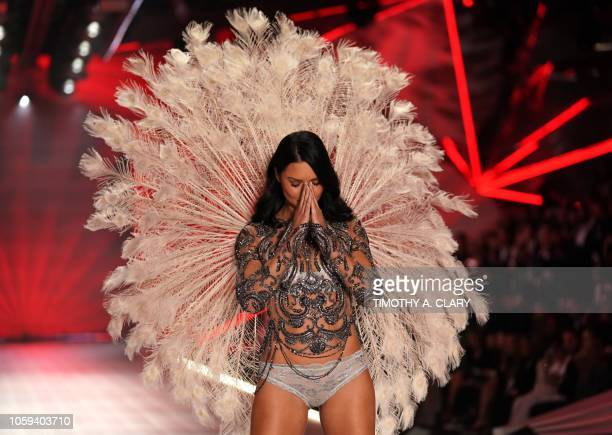 Brazilian model Adriana Lima walks the runway at the 2018 Victoria's Secret Fashion Show on November 8, 2018 at Pier 94 in New York City. - Every...