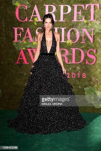 Brazilian model Alessandra Ambrosio poses as she arrives to attend the Green Carpet Fashion Awards 2018 within the Women's Spring/Summer 2019 fashion...