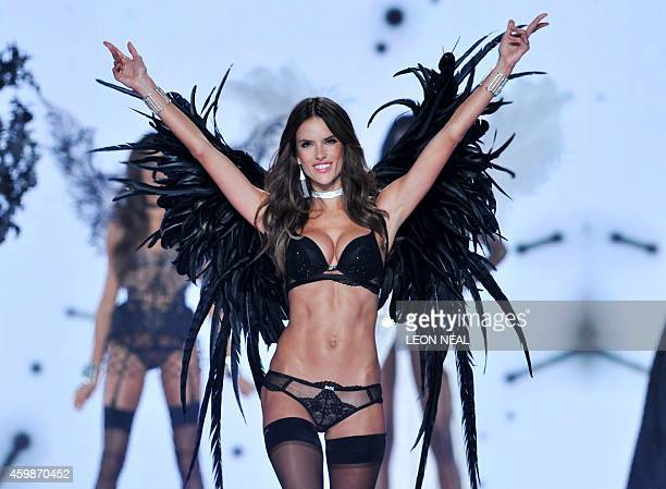 Brazilian model Alessandra Ambrosio walks the runway during the 2014 Victoria's Secret Fashion Show at Earl's Court exhibition centre in London on...