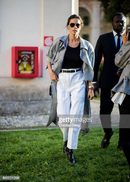Brazilian model Alessandra Ambrosio wearing white pants grey checked coat is seen outside Alberta Ferretti during Milan Fashion Week Spring/Summer...