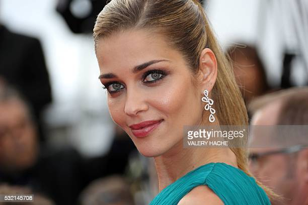 Brazilian model Ana Beatriz Barros poses as she arrives on May 18 2016 for the screening of the film 'The Unknown Girl ' at the 69th Cannes Film...