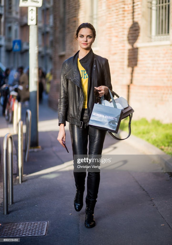 Brazilian model Barbara Fialho wearing black leather jacket and leather pants is seen outside Alberta Ferretti during Milan Fashion Week Spring/Summer 2018 on September 20, 2017 in Milan, Italy.