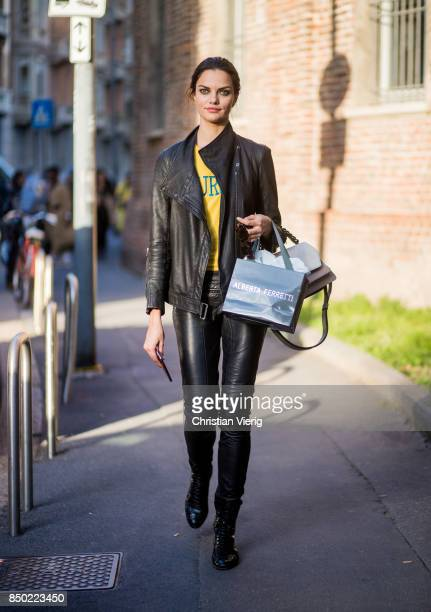 Brazilian model Barbara Fialho wearing black leather jacket and leather pants is seen outside Alberta Ferretti during Milan Fashion Week...