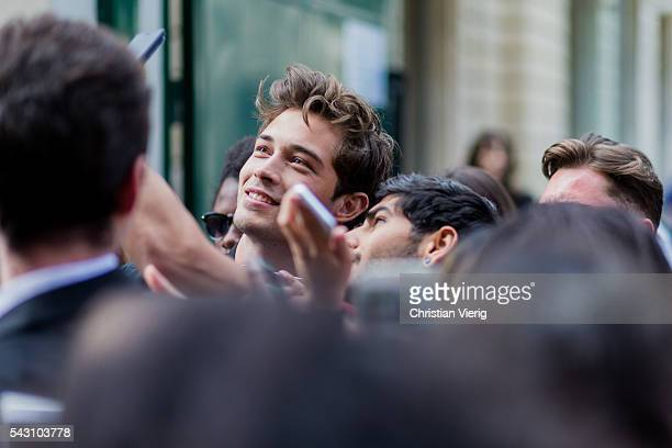 Brazilian model Francisco Lachowski 'Chico' taking selfies and photos with fans outside Balmain during the Paris Fashion Week Menswear Spring/Summer...