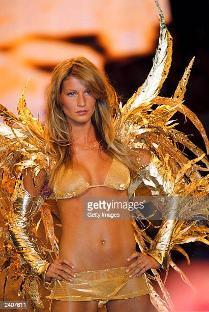 Brazilian model Gisele Bundchen models a gold bikini and gold feathers during a Victoria's Secret benefit fashion show in Cannes France May 18 2000...