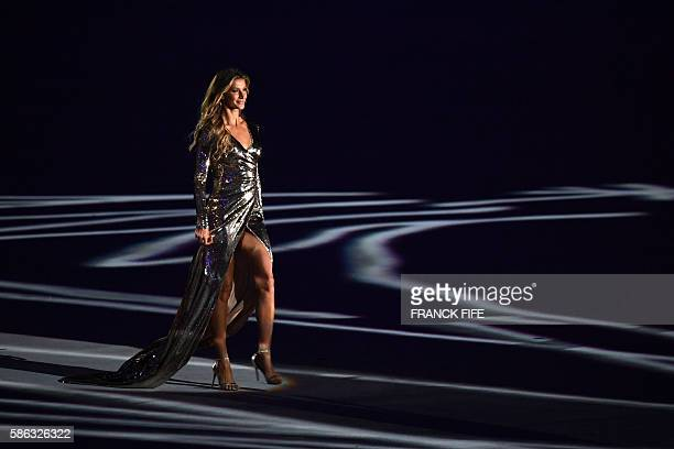 Brazilian model Gisele Bundchen walks across the stage during the opening ceremony of the Rio 2016 Olympic Games at Maracana Stadium in Rio de...