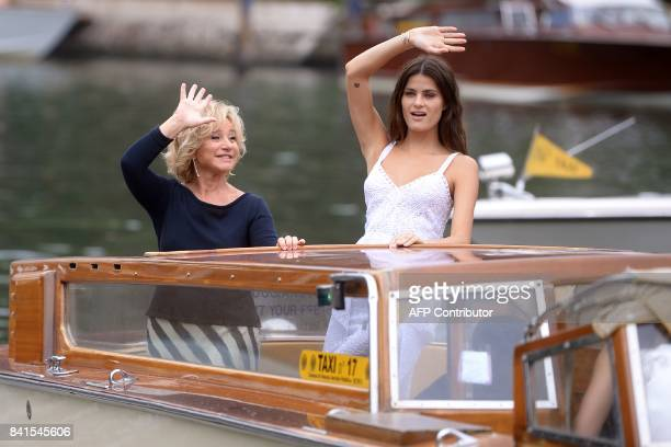 Brazilian model Isabeli Fontana and Italian designer Alberta Ferretti wave from a taxiboat as they arrive at the Excelsior Hotel during the 74th...