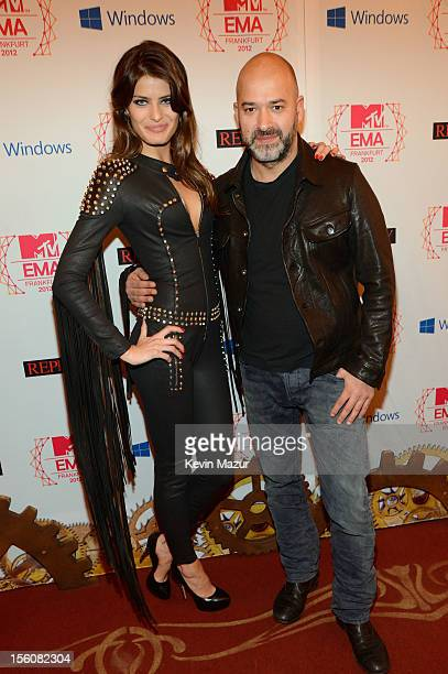 Brazilian model Isabeli Fontana and Massimo Sinigaglia CEO of Replay attend the MTV EMA's 2012 at Festhalle Frankfurt on November 11 2012 in...