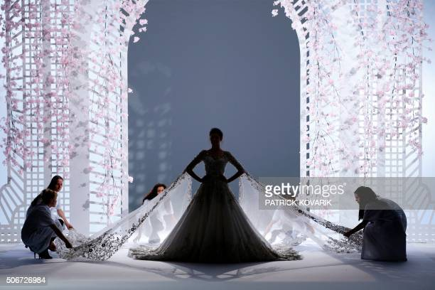 TOPSHOT Brazilian model Isabeli Fontana presents a creation for Ralph Russo during the 2016 spring/summer Haute Couture collection fashion...