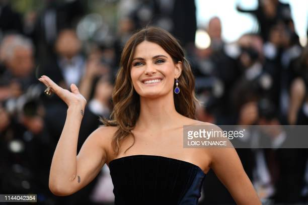 Brazilian model Isabeli Fontana waves as she arrives for the screening of the film Rocketman at the 72nd edition of the Cannes Film Festival in...