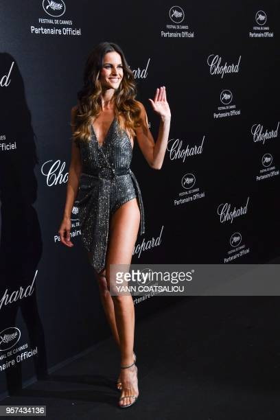TOPSHOT Brazilian model Izabel Goulart poses as she arrives on May 11 2018 for the Chopard party on the sidelines of the 71st edition of the Cannes...