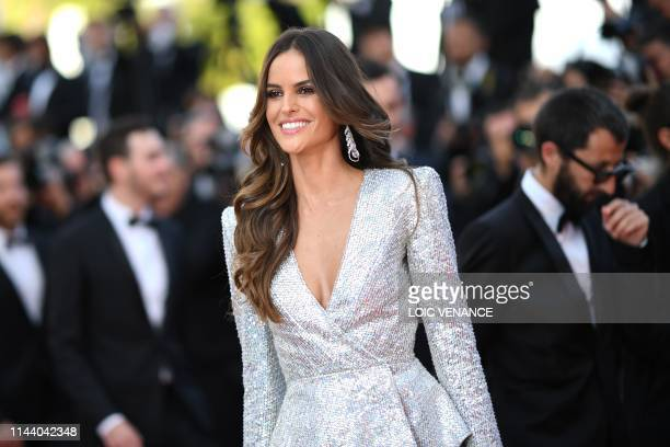 "Brazilian model Izabel Goulart smiles as she arrives for the screening of the film ""Rocketman"" at the 72nd edition of the Cannes Film Festival in..."