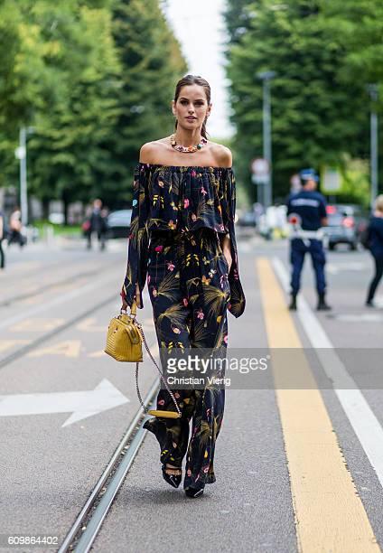 Brazilian model Izabel Goulart wearing an off shoulder overall outside Fendi during Milan Fashion Week Spring/Summer 2017 on September 22 2016 in...