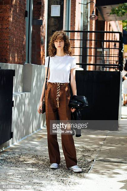 Brazilian model Lorena Maraschi wears a white tshirt loose brown trousers with a rope belt and white Converse sneakers after the Proenza Schouler...