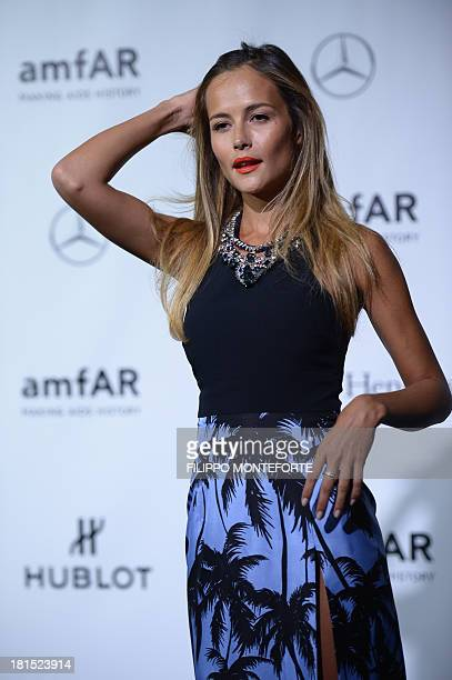 Brazilian model Natalia Borges arrives to attend the amfAR Milano 2013 at La Permanente during Milan Fashion Week on September 21 2013 AFP PHOTO /...