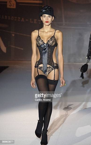Brazilian model Raica Oliveira girlfriend of Real Madrid's soccer player Ronaldo walks down the runway at the Andres Sarda fashion show as part of...