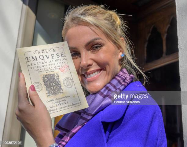 627a3e8ac46ca Brazilian model TV host and businesswoman Ana Hickmann Lello Bookstore  ambassador to Brazil holds a facsimile