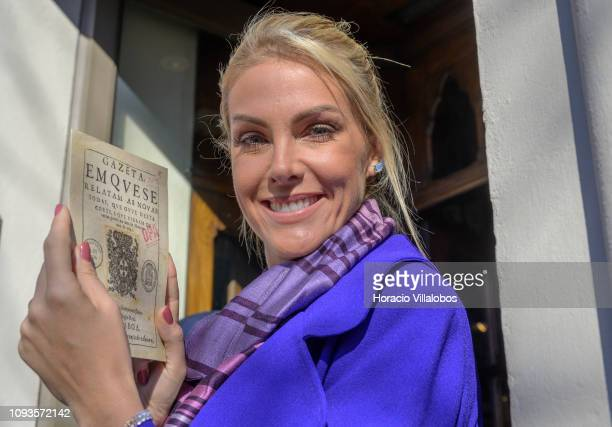 0e89fdf3011b9 Brazilian model TV host and businesswoman Ana Hickmann Lello Bookstore  ambassador to Brazil holds a facsimile. 8th Annual Victoria s Secret Fashion  Show ...