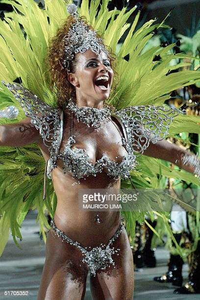 Brazilian model Viviane Araujo performs with the Mocidade Independete samba school 12 February 2002 during the second day of the carnival parade at...