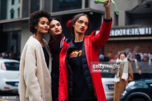 Brazilian models Samile Bermannelli Aira Ferreira Ellen Rosa take a selfie after the Dolce Gabbana show during Milan Fashion Week Fall/Winter 2018/19...