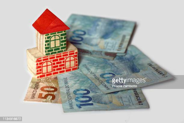 brazilian money and toy house - monetary policy stock pictures, royalty-free photos & images