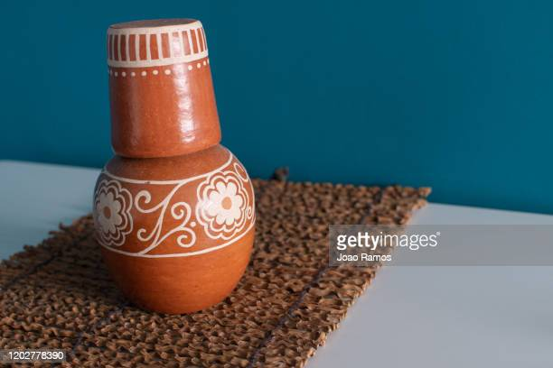 brazilian moringa ceramic pot with flower designs on a table - 1 - terracotta stock pictures, royalty-free photos & images