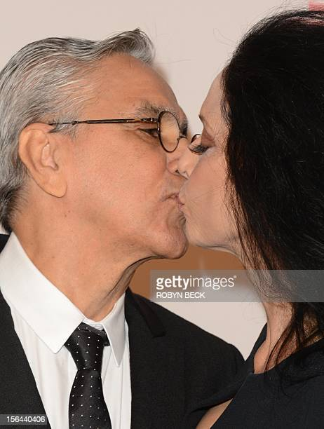 Brazilian musician Caetano Veloso kisses actress Sonia Braga as they arrive for the 2012 Latin Recording Academy Person of the Year gala honoring...