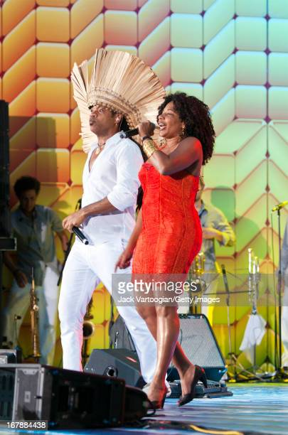 Brazilian musician Carlinhos Brown performs with singer Margareth Menezes during the 26th Annual Brazilian Day Festival on a stage on W 44th Street...