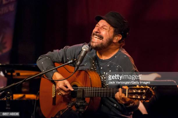 Brazilian musician Joao Bosco plays guitar as he performs with Cesar Camargo Mariano's band during the BossaBrazil Festival at Birdland New York New...