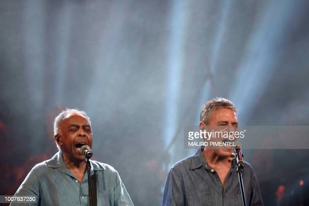 Brazilian musicians Gilberto Gil and Chico Buarque perform during the Lula Livre Music Festival in Rio de Janeiro Brazil on July 28 2018 Brazilian...