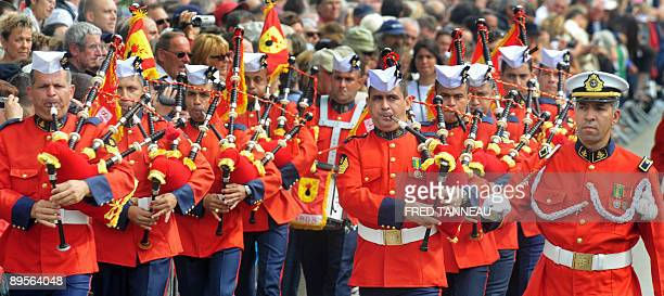 Brazilian musicians of the 'pipe band Fuzileirios Navais' parade playing bagpipes on August 2 2009 in Lorient western France during the celtics...