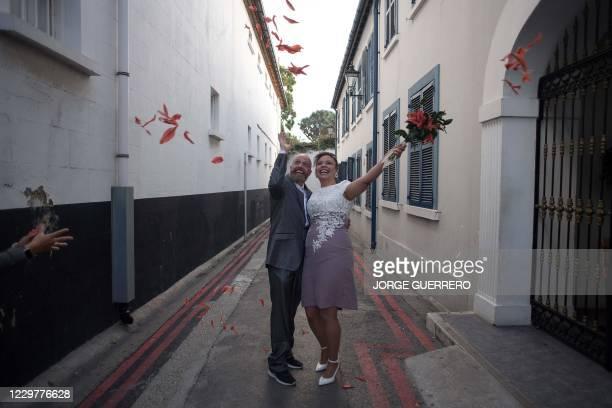 Brazilian national Bruno Miani and his Brazilian partner Natalia Senna Alves de Lima celebrate after their wedding ceremony in Gibraltar on November...