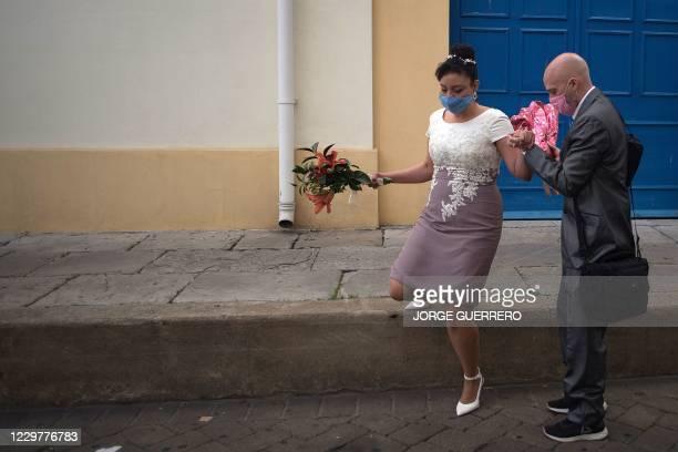 Brazilian national Bruno Miani and his Brazilian partner Natalia Senna Alves de Lima walk to their wedding in Gibraltar on November 24, 2020. -...
