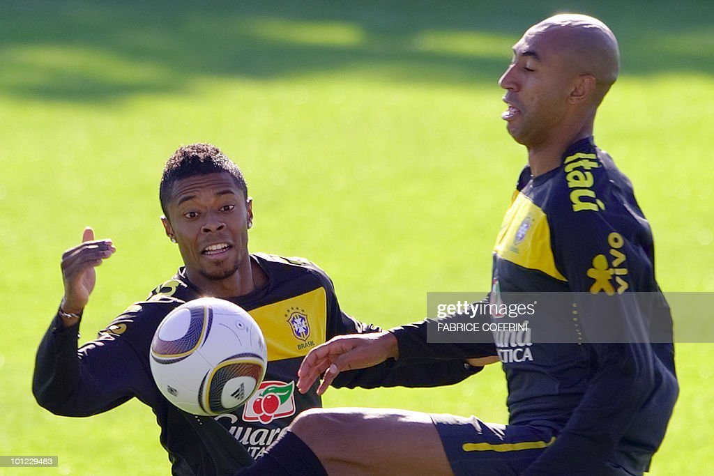 Brazilian national football team player Kleberson (L) and Luisao play with the ball during a training session on May 28, 2010 at Randburg High School in Johannesburg ahead of FIFA World Cup in South Africa.