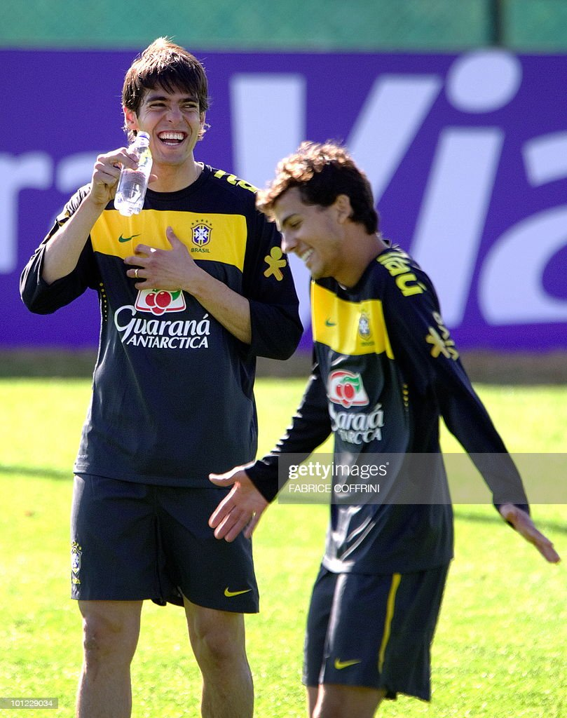 Brazilian national football team players Kaka (L) smiles close to Nimar during a training on May 28, 2010 at Randburg High School in Johannesburg ahead of the June 11 to July 11 FIFA World Cup in South Africa. Five-time World champions Brazil will arrive in Tanzania on June 6 for an international friendly with the 'Taifa Stars' on June 7.