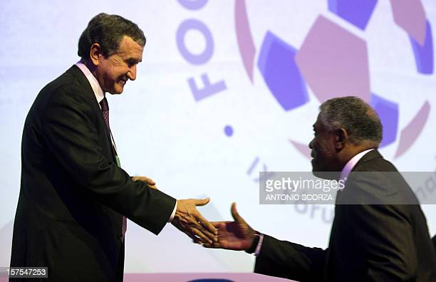Brazilian national football team technical coordinator Carlos Alberto Parreira greets Colombian football coach Francisco Maturana during the Footecon...
