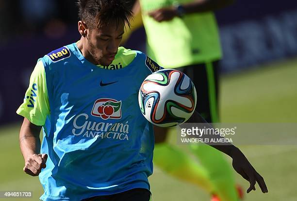 Brazilian national footballer Neymar controls the ball during a training session at the Granja Comary training complex in Teresopolis 90 km from...