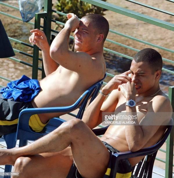 Brazilian national soccer team players Ronaldo and Giulberto Silva take a sunbath at an Asuncion hotel 30 March 2004 Brazil will face Paraguay...