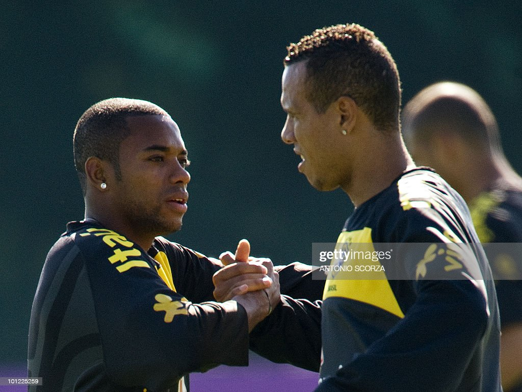 Brazilian national team football forwards Luis Fabiano (R) and Robinho congratulate each other during practice on May 28, 2010 in Johannesburg ahead of the June 11 to July 11 FIFA World Cup in South Africa.