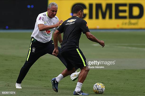 Brazilian national team head coach Tite in action with Diego Souza during a training session at Engenhao Stadium on January 24 2017 in Rio de Janeiro...