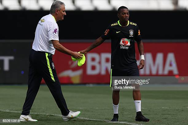 Brazilian national team head coach Tite speaks with Robinho during a training session at Engenhao Stadium on January 24 2017 in Rio de Janeiro Brazil