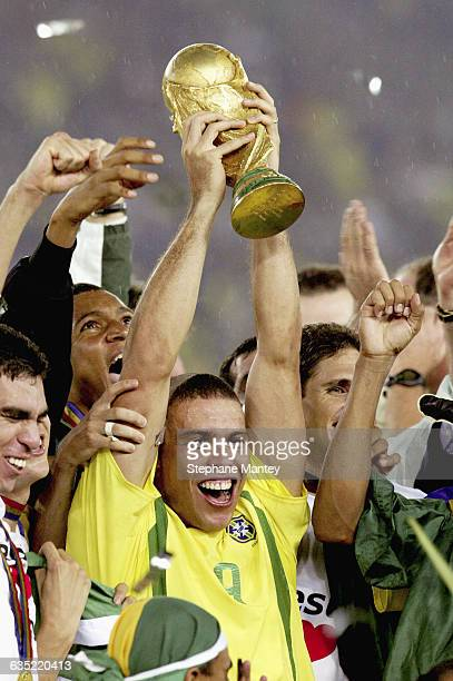 Brazilian national team player Ronaldo holds the 2002 World Cup trophy, after Brazil's defeat of Germany.