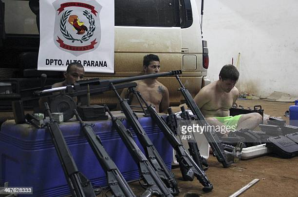 Brazilian nationals Roberto Torres Gonzalez Antonio Cesar Ibarra and Luis Fernando Cabral and weaponsassault rifles and a caliber 50 sniper rifle...
