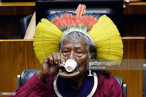 Brazilian native Chief Raoni Metuktire drinks coffe during a session to honor native people at the National Congress in Brasilia during the National...
