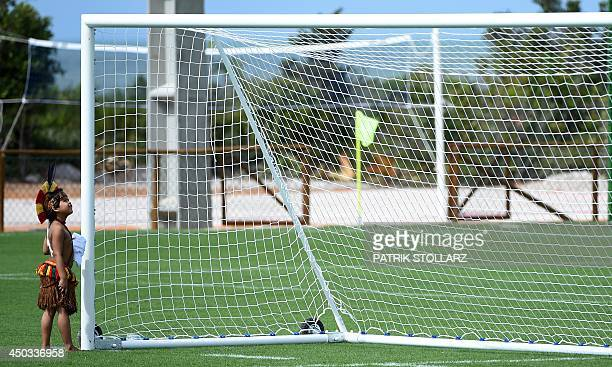 A Brazilian native kid looks at a goalpost after a training session of Germany's national football team in Santo Andre on June 9 2014 ahead of the...