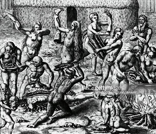 Brazilian natives cook and eat the bodies of slain enemies engraving from Peregrinationes by Theodor de Bry South America 16th century