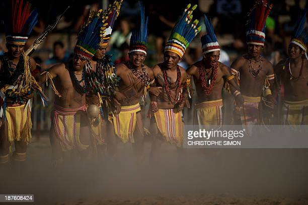 Brazilian natives of the Pareci tribe dance before playing head football with a handmade ball during the first day of the International Games of...