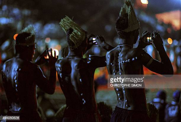 Brazilian natives take sanpshots with their mobile phones during the I World Indigenous Games opening ceremony in Palmas Tocantins on October 23 2015...